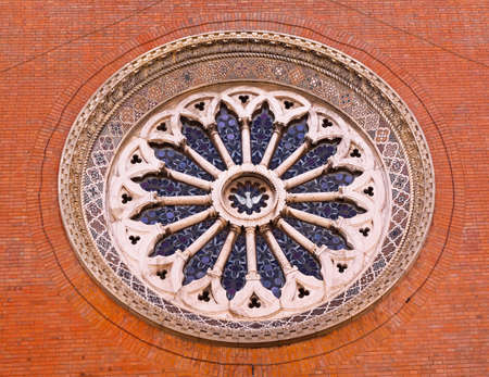 Round window with stained glass at Church in Rome photo