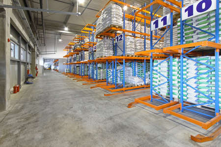Big distribution warehouse with sacks at shelves