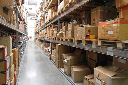 Warehouse shelf with cardboard boxes and goods