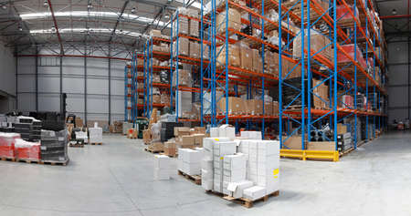 Distribution warehouse with high rack shelving system panorama Archivio Fotografico