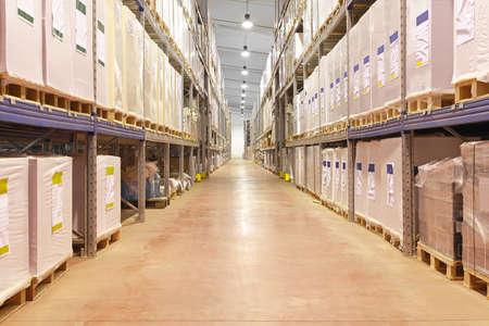 Long corridor with shelves in distribution warehouse Archivio Fotografico