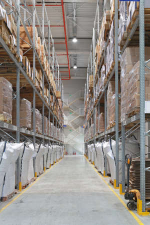 Distribution center warehouse interior with high shelves Stock Photo