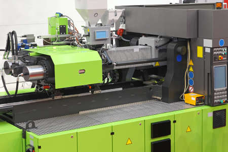 Injection moulding machine for plastic parts production Archivio Fotografico