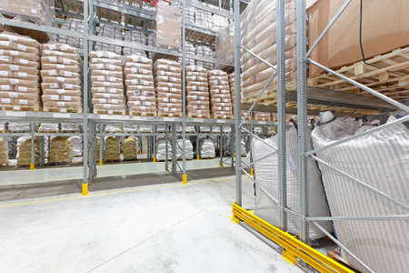 Distribution center warehouse interior with sacks and bags