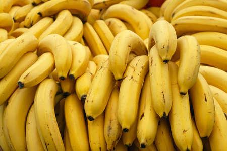 Bunch of yellow ripe bananas at market