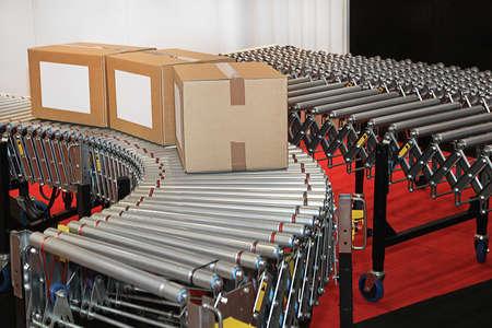 Powered conveyor rollers for transfer boxes in factory Zdjęcie Seryjne