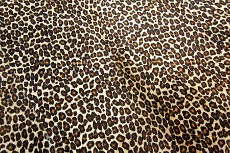Wild leopard hide pattern textile background