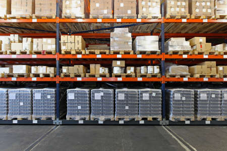 Mobile shelving system with goods in warehouse Archivio Fotografico
