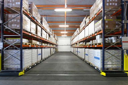 Big storage room for goods in factory