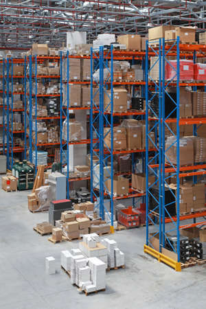 Distribution warehouse with high rack shelving system