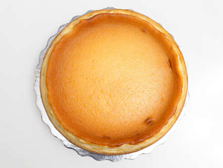 Top view of whole New York style cheesecake pie