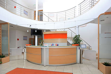 Modern company entrance with front desk reception