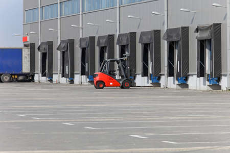 Forklift and loading ramps at distribution warehouse Archivio Fotografico
