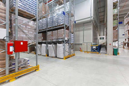 Shelves with food in distribution warehouse Stock Photo