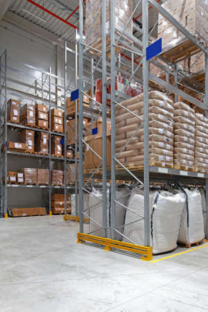 Food distribution warehouse with high shelves Archivio Fotografico