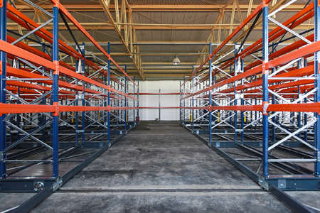 Empty shelves and racks in distribution warehouse Stock Photo
