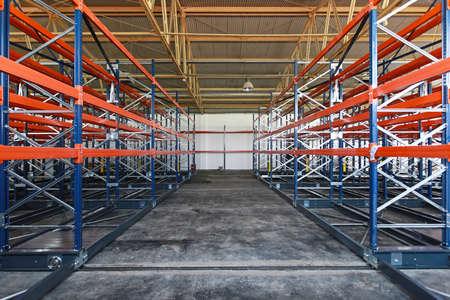 Empty shelves and racks in distribution warehouse Foto de archivo