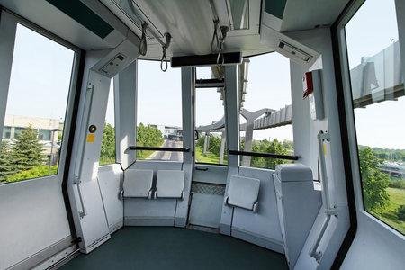 Automated sky train cabin interior without driver Sajtókép