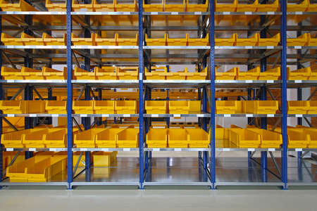 Storage bins and trays in distribution warehouse Foto de archivo