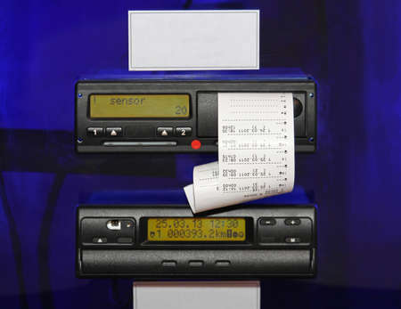 Digital tachograph device fitted to a truck and automatically record speed and distance