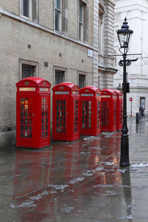 LONDON, UNITED KINGDOM - JANUARY 19  Red Telephone boxes in London on JANUARY 19, 2013  Gas Lighting and Five red telephone booths at West End in London, United Kingdom