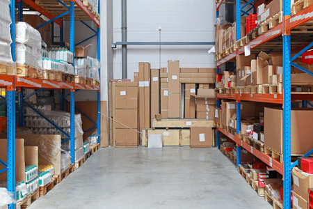 Cardboard boxes with merchandise in distribution center Stock Photo
