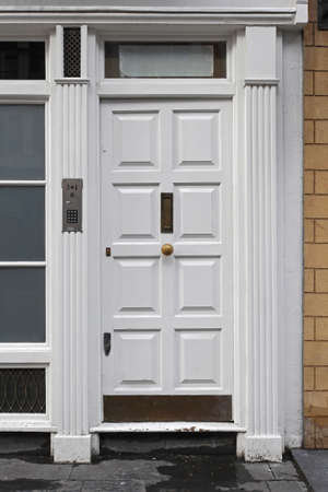 White door at Victorian building in London photo