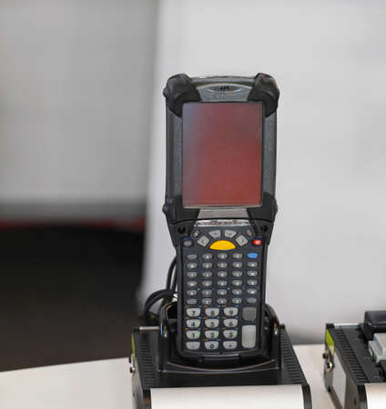 barcode scanner: Handheld barcode scanner computer in distribution warehouse