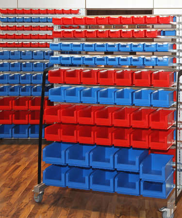 Blue and red mobile rolling storage cart in warehouse photo