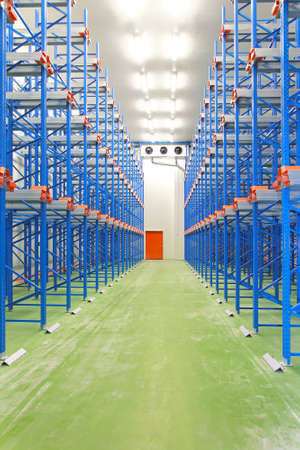 Refrigerated and freezing warehouse with blue shelves Editorial
