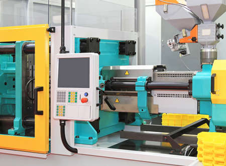 Injection moulding machine for plastic parts production 스톡 콘텐츠