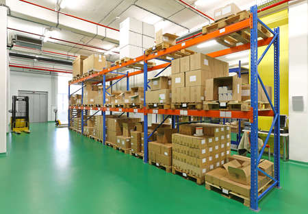 Shelf with goods in storage warehouse room