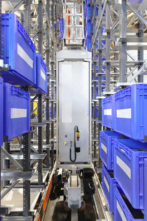 Automated warehouse storage system with plastic crates 写真素材