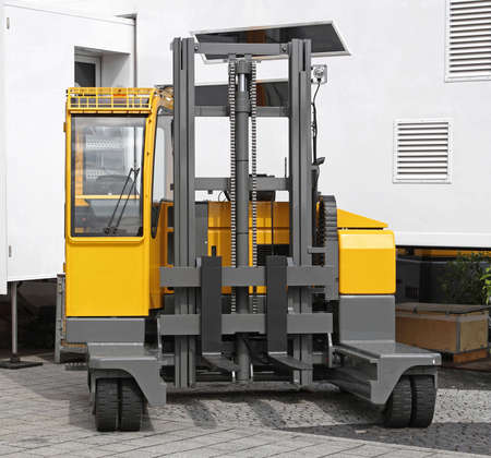 Side loader forklift for distribution warehouse Archivio Fotografico