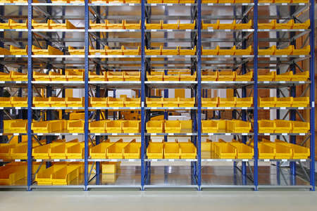 Storage trays and bins in distribution warehouse 스톡 콘텐츠