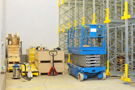 Scissor lift at construction site in distribution warehouse Archivio Fotografico