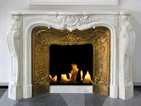 Rustic style fireplace in white marble with gold