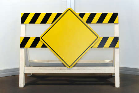 Blank yellow sign at construction barrier