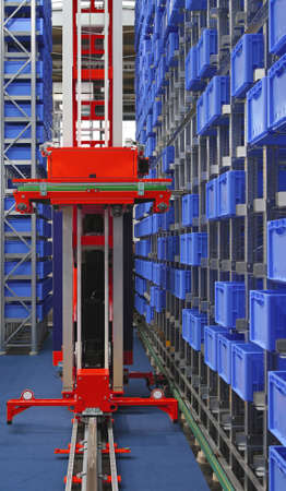 Automated storage warehouse with blue plastic crates