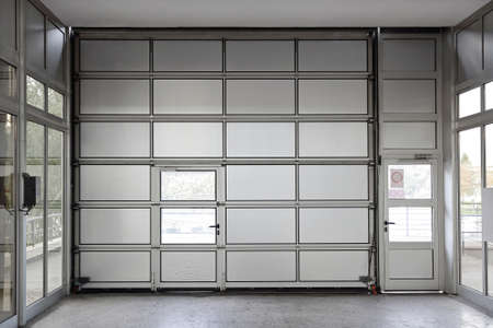 Sectional motorized big metal garage door