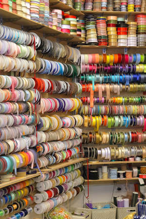 Ribbons and Trimms at Reels in Craft Shop Archivio Fotografico