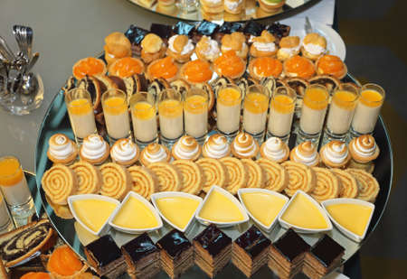Various Sweets and Pastry at Dessert Buffet Imagens