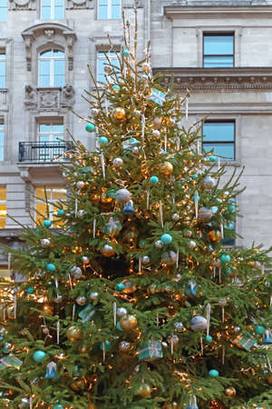 beautiful christmas tree with gifts and icicles in city stock photo 49597350 - Icicles For Christmas Tree