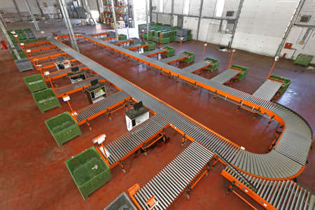 Sorting System With Conveyor Belt in Distribution Warehouse Stock Photo