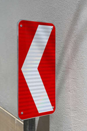 Red and White Arrow Direction Traffic Sign