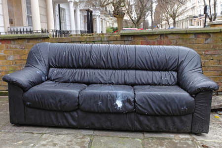 Rejected Old Sofa Waiting For Furniture Collection