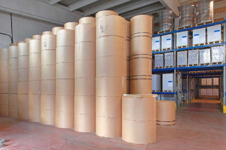 Big Stack of Printing Paper Rolls in Warehouse Archivio Fotografico