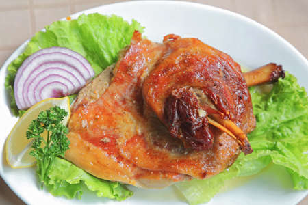Roasted Lamb Shank Served With Salad and Onion
