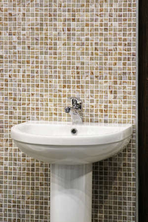 Sink Bowl in Bathroom With Mosaic Tiles Stock Photo