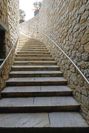 Flight of Stairs with banister at stone wall Stok Fotoğraf